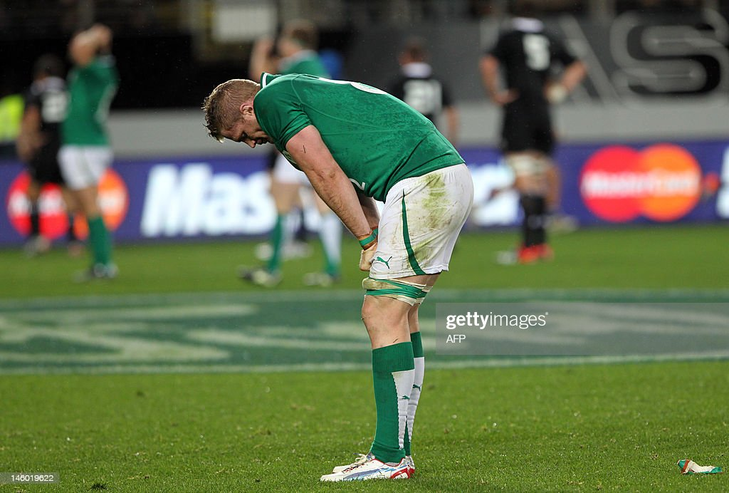 Jamie Heaslip of Ireland reacts after losing to the New Zealand All Blacks during their rugby union match at Eden Park in Auckland on June 9, 2012. New Zealand beat Ireland 42-10. AFP PHOTO / Michael Bradley