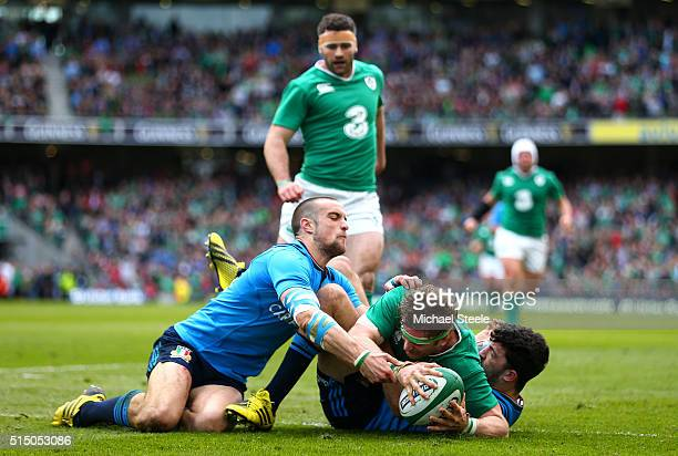 Jamie Heaslip of Ireland scores his team's fourth try during the RBS Six Nations match between Ireland and Italy at Aviva Stadium on March 12 2016 in...