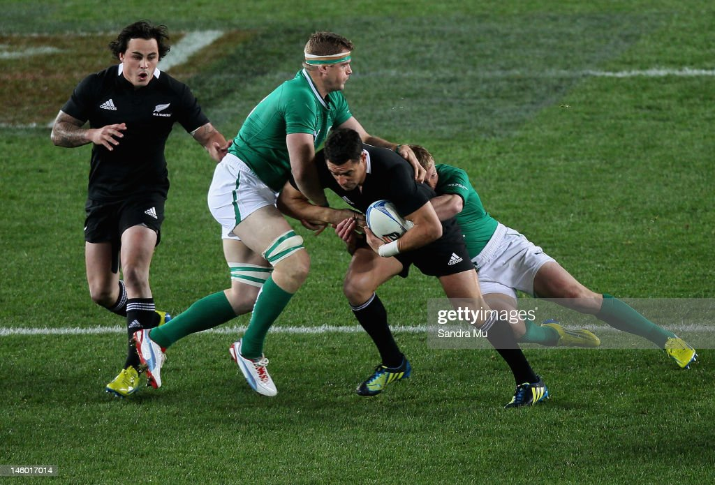 Jamie Heaslip of Ireland (L) tackles Dan Carter of the All Blacks during the International Test Match between the New Zealand All Blacks and Ireland at Eden Park on June 9, 2012 in Auckland, New Zealand.