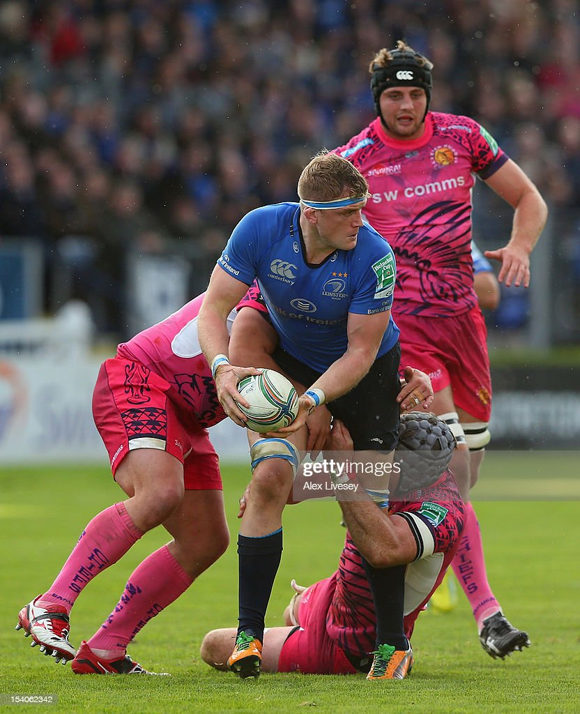 <a gi-track='captionPersonalityLinkClicked' href=/galleries/search?phrase=Jamie+Heaslip&family=editorial&specificpeople=171469 ng-click='$event.stopPropagation()'>Jamie Heaslip</a> of Leinster is tackled by Richard Baxter of Exeter Chiefs during the Heineken Cup Pool 5 match between Leinster and Exeter Chiefs at Royal Dublin Society on October 13, 2012 in Dublin, Ireland.