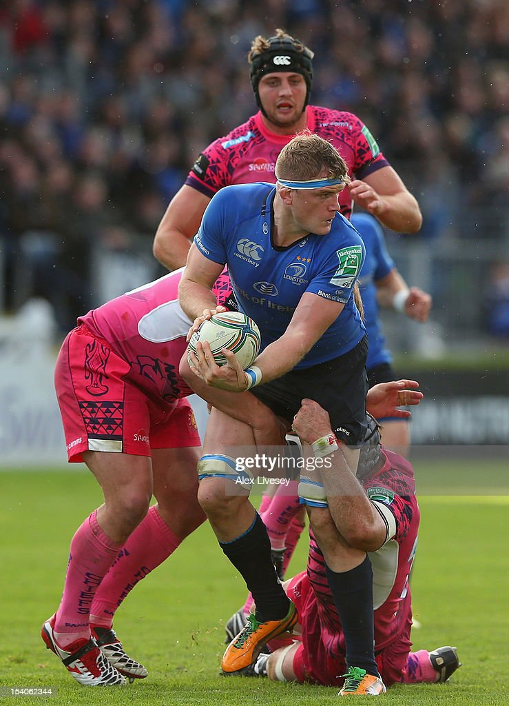 Jamie Heaslip of Leinster is tackled by Richard Baxter of Exeter Chiefs during the Heineken Cup Pool 5 match between Leinster and Exeter Chiefs at Royal Dublin Society on October 13, 2012 in Dublin, Ireland.