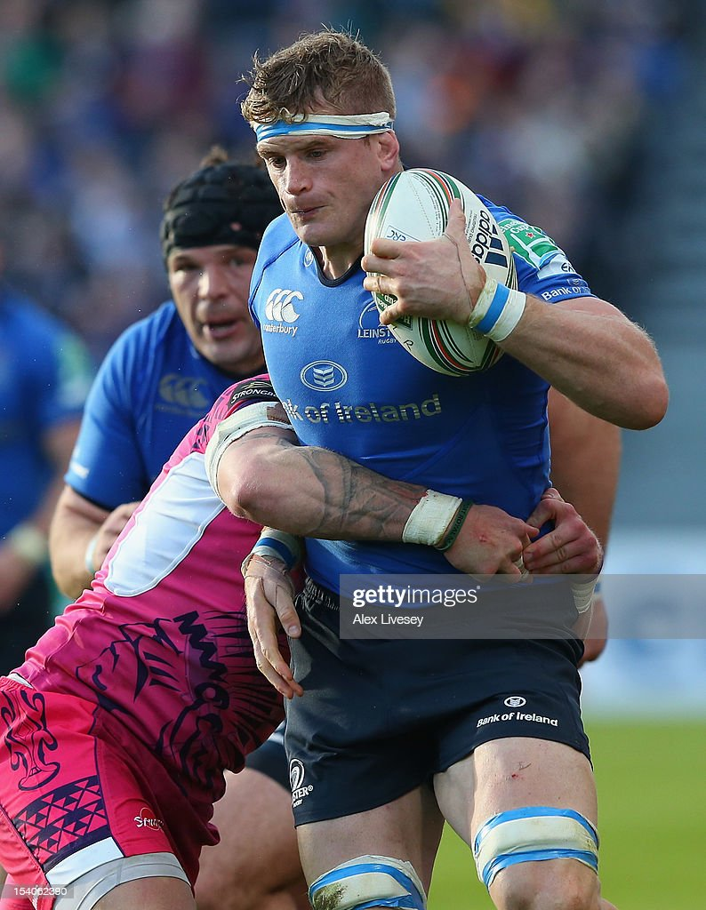 <a gi-track='captionPersonalityLinkClicked' href=/galleries/search?phrase=Jamie+Heaslip&family=editorial&specificpeople=171469 ng-click='$event.stopPropagation()'>Jamie Heaslip</a> of Leinster is tackled by Simon Alcott of Exeter Chiefs during the Heineken Cup Pool 5 match between Leinster and Exeter Chiefs at Royal Dublin Society on October 13, 2012 in Dublin, Ireland.
