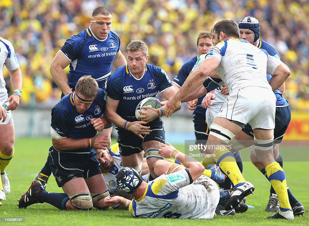 <a gi-track='captionPersonalityLinkClicked' href=/galleries/search?phrase=Jamie+Heaslip&family=editorial&specificpeople=171469 ng-click='$event.stopPropagation()'>Jamie Heaslip</a> of Leinster is tackled short of the try line during the Heineken Cup semi final match between ASM Clermont Auvergne and Leinster at Stade Chaban-Delmas on April 29, 2012 in Bordeaux, France.