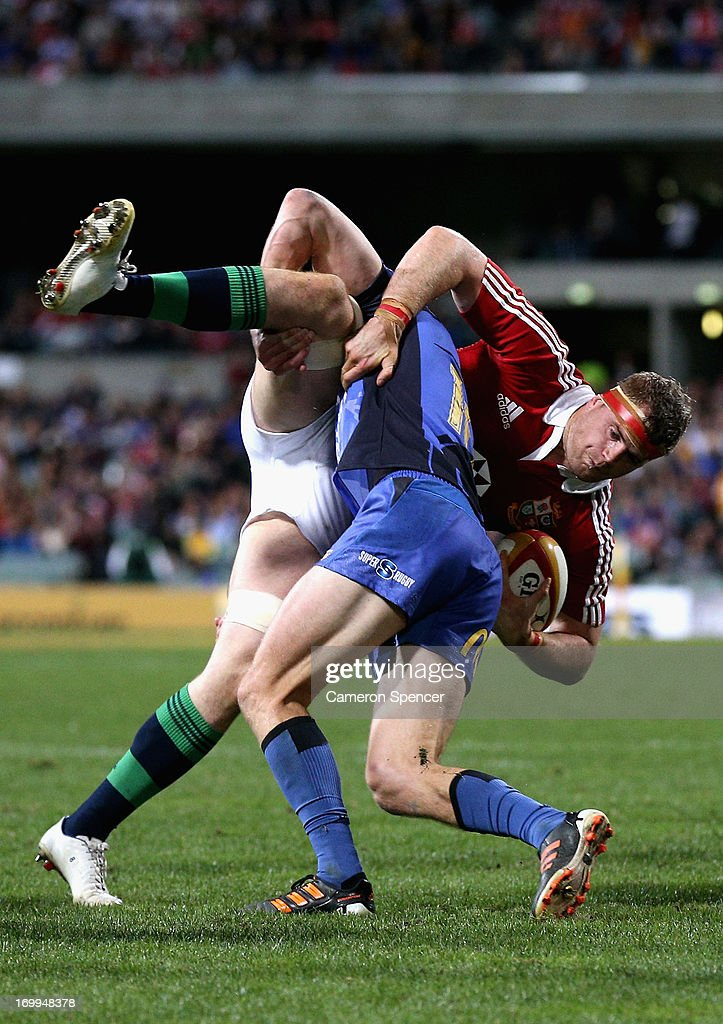 Jamie Heaslip of the Lions is tackled during the tour match between the Western Force and the British & Irish Lions at Patersons Stadium on June 5, 2013 in Perth, Australia.