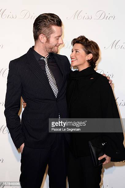 Jamie Hewlett and Emma de Caunes attend a photocall for 'Esprit Dior Miss Dior' exhibtion opening at Grand Palais on November 12 2013 in Paris France