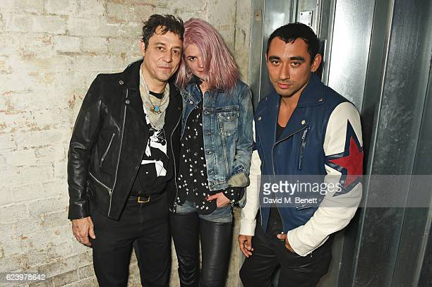 Jamie Hince and Alison Mosshart of The Kills pose backstage with Nicola Formichetti Artistic Director of Diesel at Diesel's #forsuccessfulliving...