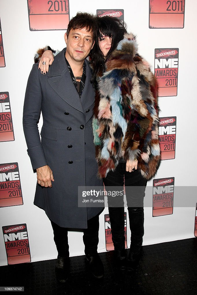 Jamie Hince and Alison Mosshart of The Kills pose in the press room during the NME Awards 2011 at Brixton Academy on February 23, 2011 in London, England.