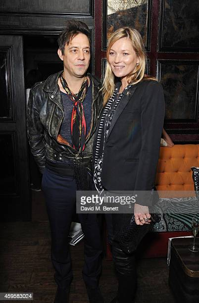 Jamie Hince and Kate Moss attend the launch of the Rockins For Eyeko collection at The Scotch of St James on November 25 2014 in London England