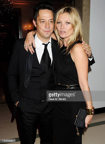Jamie Hince and Kate Moss attend the Marie Curie Cancer Fundraiser hosted by Heather Kerzner at Claridge's Hotel on May 15 2012 in London England