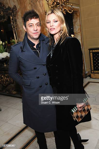 Jamie Hince and Kate Moss attends day two of themiumiulondon a temporary women's club at Cafe Royal on November 28 2012 in London England
