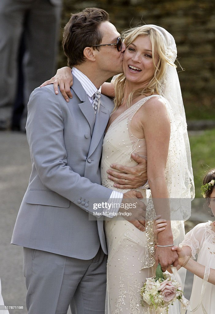 Jamie Hince and <a gi-track='captionPersonalityLinkClicked' href=/galleries/search?phrase=Kate+Moss&family=editorial&specificpeople=201830 ng-click='$event.stopPropagation()'>Kate Moss</a> kiss as they leave St. Peter's Church after their wedding on July 1, 2011 in Southrop, England.