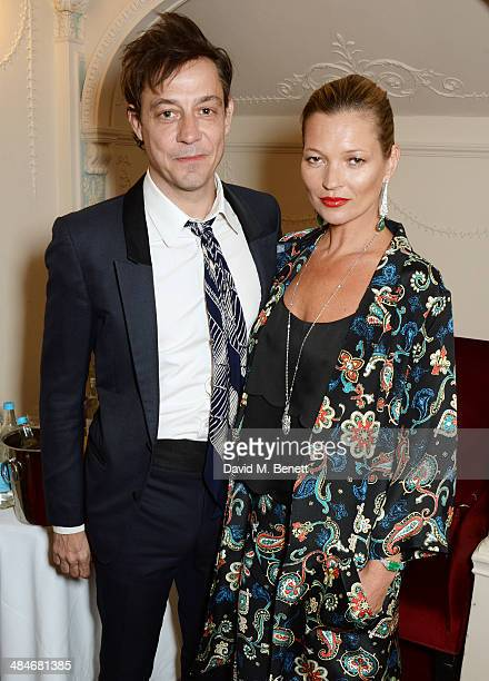 Jamie Hince and Kate Moss pose backstage at the Laurence Olivier Awards at The Royal Opera House on April 13 2014 in London England