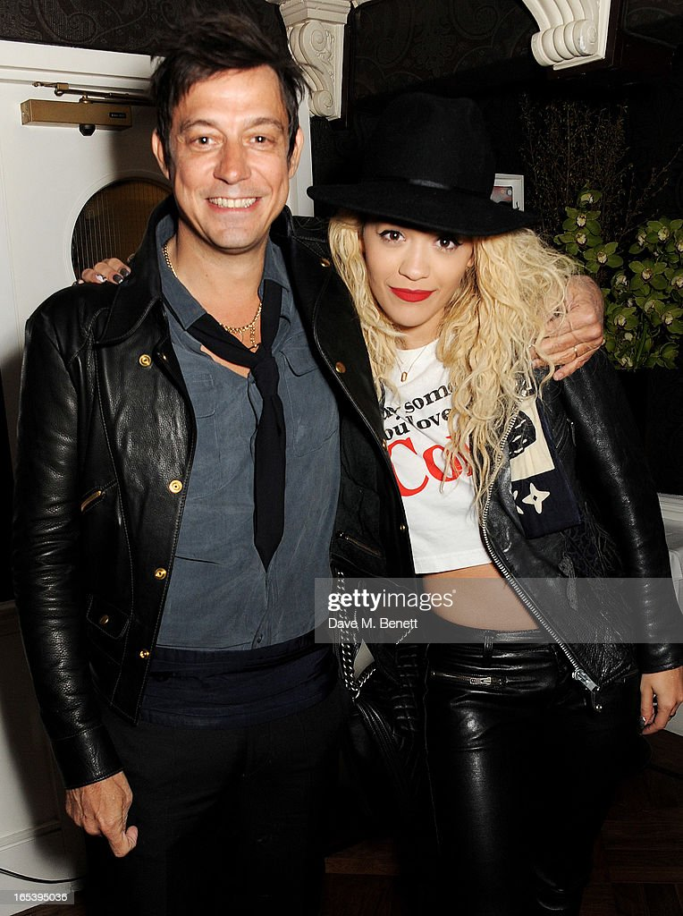 Jamie Hince (L) and Rita Ora attend event planner Paul Rowe's 40th birthday party at The Groucho Club on April 3, 2013 in London, England.