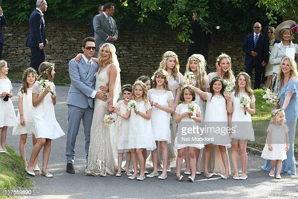 Jamie Hince Kate Moss and their bridesmaids outside the church after their wedding on July 1 2011 in Southrop England