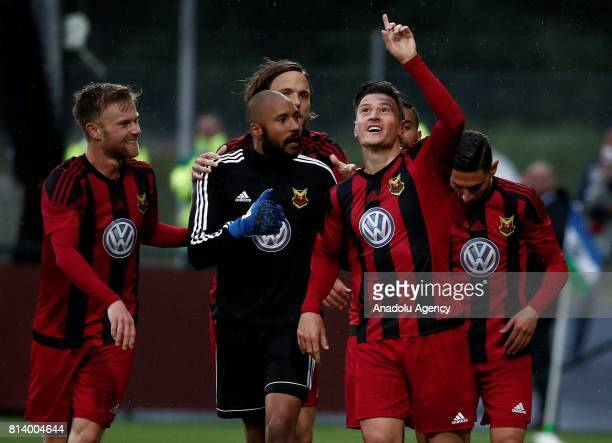 Jamie Hopcutt of Ostersund celebrates with his teammates after scoring during the UEFA Europa League 2nd Qualifying Round soccer match between...