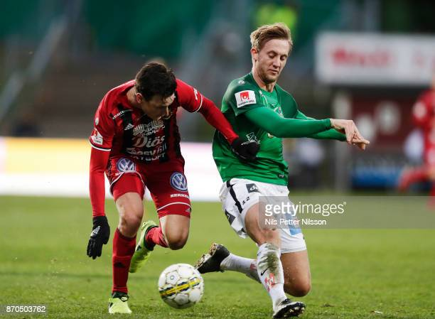 Jamie Hopcutt of Ostersunds FK and Jesper Svensson of Jonkopings Sodra competes for the ball during the Allsvenskan match between Jonkopings Sodra IF...