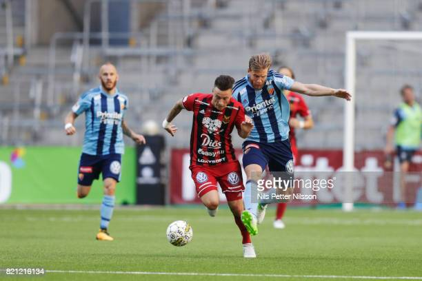 Jamie Hopcutt of Ostersunds FK and Niklas Gunnarsson of Djurgardens IF competes for the ball during the Allsvenskan match between Djurgardens IF and...