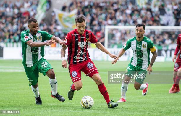 Jamie Hopcutt of Ostersunds FK in the middle of SergeJunior Martinsson Ngouali and Jiloan Hamad of Hammarby IF during the Allsvenskan match between...