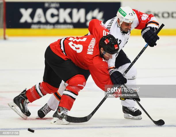 Jamie Johnson of Koelner Haie and Peter Bartos of HC Kosice battle for the puck during the Champions Hockey League group stage game between Koelner...
