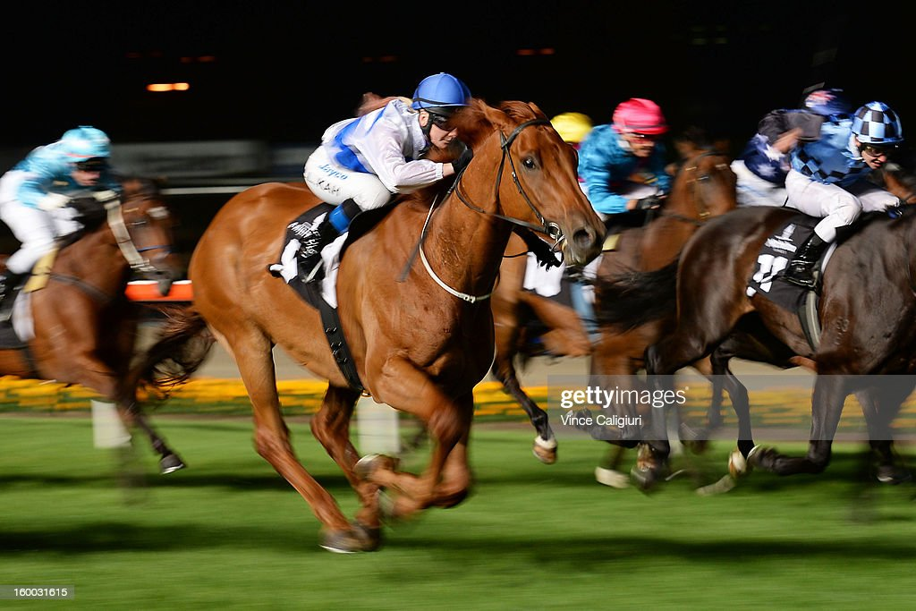 Jamie Kah riding Highness races to win the Mitchelton Wines Handicap during Melbourne racing at Moonee Valley Racecourse on January 25, 2013 in Melbourne, Australia.