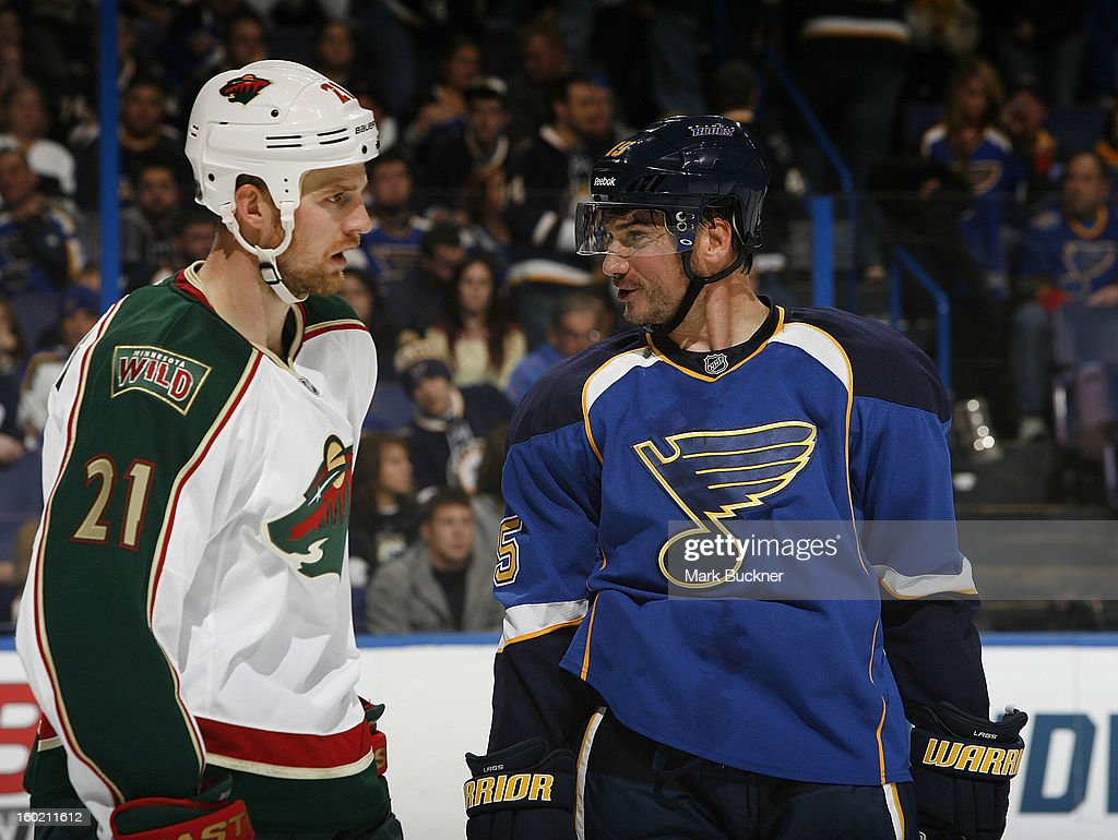 Jamie Langenbrunner #15 of the St. Louis Blues talks with Kyle Brodziak #21 of the Minnesota Wild in an NHL game on January 27, 2013 at Scottrade Center in St. Louis, Missouri.