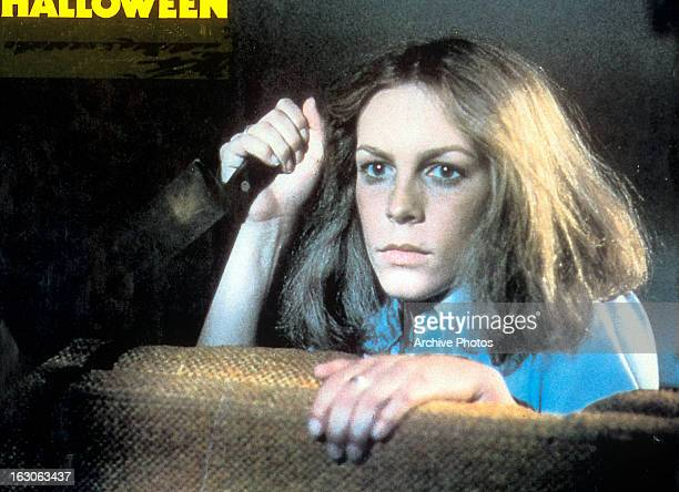 Jamie Lee Curtis holds a knife in a scene from the film 'Halloween' 1978