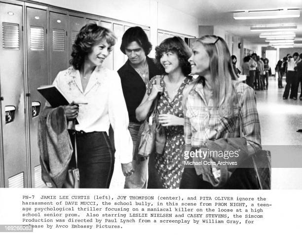 Jamie Lee Curtis is harassed by David Mucci with Joy Thompson and Pita Oliver in a scene from the film 'Prom Night' 1980