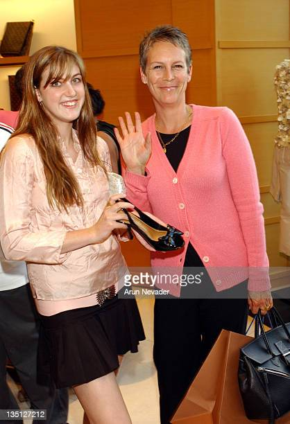 Jamie Lee Curtis with daughter Annie holding black LV pumps and the Louis Vuitton gift bag