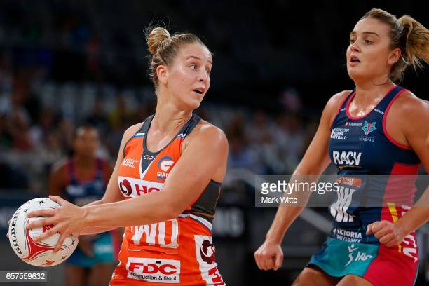 Jamie Lee Price of Giants Netball looks to pass the ball during the round six Super Netball match between the Vixens and the Giants at Hisense Arena...