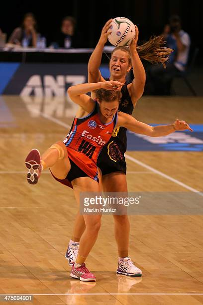 Jamie Lee Price of the Magic controls the ball from Keshia Grant of the Tactix during the round one ANZ Championships match between the Canterbury...