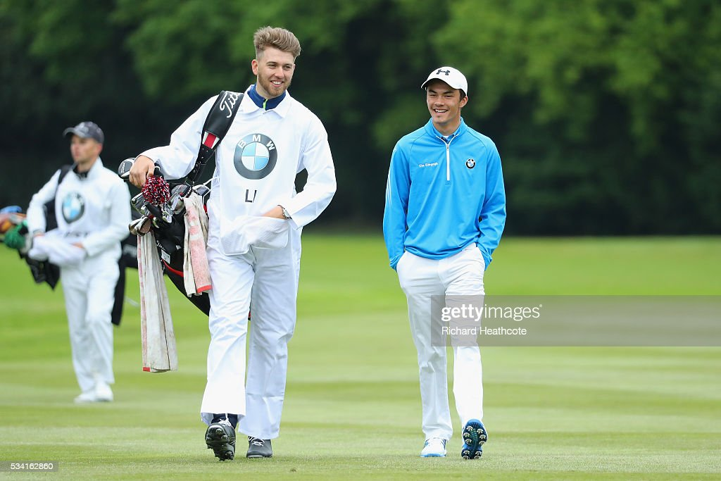 Jamie Li walks with his caddie during the Pro-Am prior to the BMW PGA Championship at Wentworth on May 25, 2016 in Virginia Water, England.