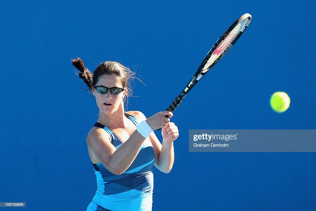 Jamie Loeb of the United States of America plays a forehand in her first round match against Camilla Rosatello of Italy during the 2013 Australian Open Junior Championships at Melbourne Park on January 19, 2013 in Melbourne, Australia.