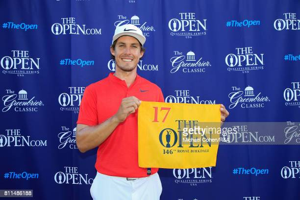 Jamie Lovemark holds a hole flag after qualifying for the Open Championship afterthe fourth and final round of The Greenbrier Classic held at The Old...