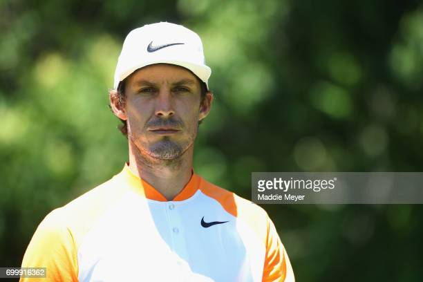 Jamie Lovemark of the United States walks on the 12th hole during the first round of the Travelers Championship at TPC River Highlands on June 22...