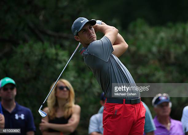 Jamie Lovemark of the United States watches his tee shot on the fifth hole during the third round of the Travelers Championship golf tournament at...