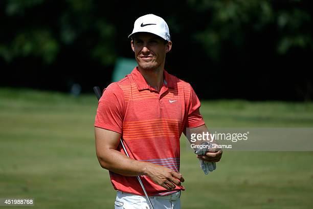 Jamie Lovemark walks to the 15th green during the first round of the John Deere Classic held at TPC Deere Run on July 10 2014 in Silvis Illinois