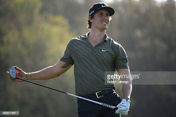 Jamie Lovemark watches his tee shot on the 12th hole during the first round of the Farmers Insurance Open on Torrey Pines South on January 23 2014 in...
