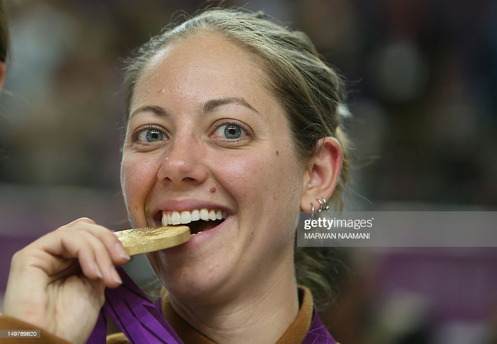 Jamie Lynn Gray of the United States bites her gold medal on the podium of the 50m rifle 3 positions women's final of the London 2012 Olympic Games at the ... - jamie-lynn-gray-of-the-united-states-bites-her-gold-medal-on-the-of-picture-id149789820