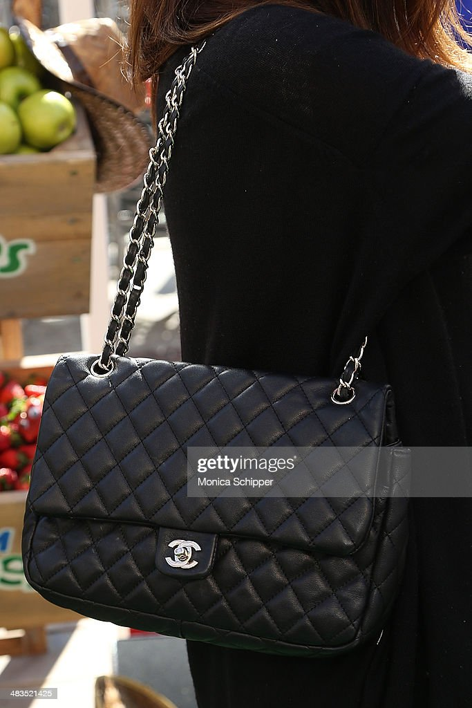 Jamie Lynn Sigler (purse detail) attends Farm Heroes Saga's Urban Farm Experience at Flatiron Pedestrian Plaza on April 9, 2014 in New York City.