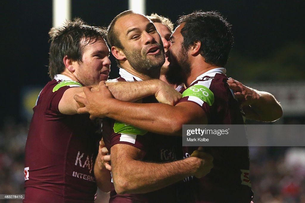 Jamie Lyon, Brett Stewart and Daly Cherry-Evans of the Eagles celebrate with Peter Hiku of the Eagles after he scored a try during the round 22 NRL match between the Manly Sea Eagles and the South Sydney Rabbitohs at Brookvale Oval on August 7, 2015 in Sydney, Australia.
