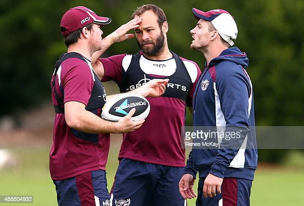 Jamie Lyon Brett Stewart and Kieran Foran talk during a Manly Sea Eagles NRL training session on September 16 2014 in Sydney Australia
