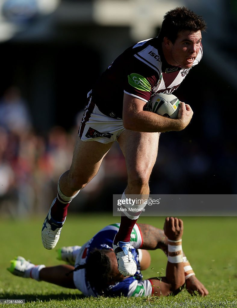 Jamie Lyon of the Sea Eagles evades the tackle of Joseph Leilua of the Knights during the round nine NRL match between the Manly Sea Eagles and the Newcastle Knights at Brookvale Oval on May 10, 2015 in Sydney, Australia.