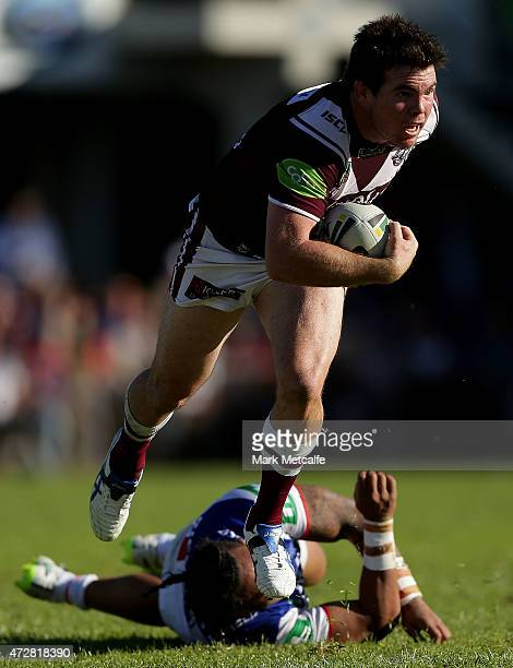 Jamie Lyon of the Sea Eagles evades the tackle of Joseph Leilua of the Knights during the round nine NRL match between the Manly Sea Eagles and the...