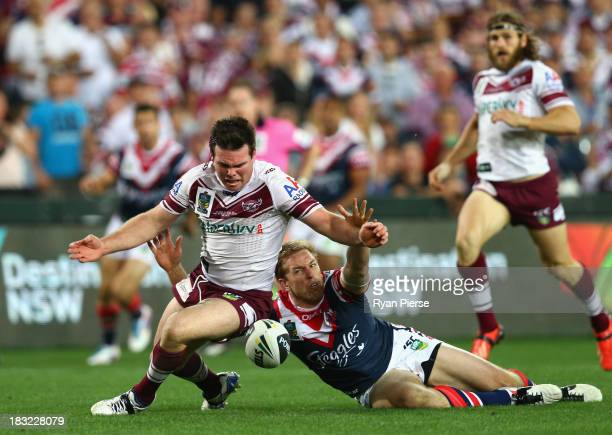 Jamie Lyon of the Sea Eagles is brought down by Mitchell Aubusson of the Roosters as he crossed the try line during the 2013 NRL Grand Final match...