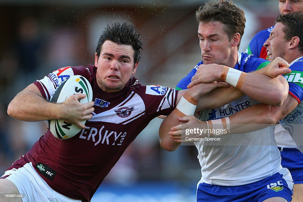 Jamie Lyon of the Sea Eagles is tackled during the round two NRL match between the Manly Sea Eagles and the Newcastle Knights at Brookvale Oval on March 17, 2013 in Sydney, Australia.