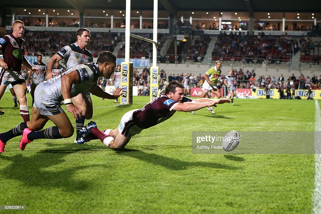 <a gi-track='captionPersonalityLinkClicked' href=/galleries/search?phrase=Jamie+Lyon&family=editorial&specificpeople=2334911 ng-click='$event.stopPropagation()'>Jamie Lyon</a> of the Sea Eagles scores a try during the round nine NRL match between the Manly Sea Eagles and the North Queensland Cowboys at Brookvale Oval on April 30, 2016 in Sydney, Australia.