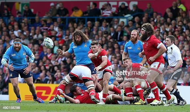 Jamie MacKenzie of Canada dumps the ball off under heavy pressure from the Italy defence during the 2015 Rugby World Cup Pool D match between Italy...