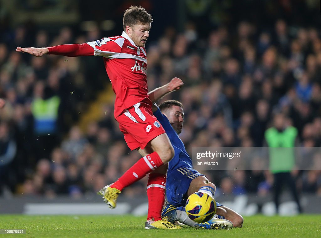 Jamie Mackie of Queens Park Rangers and Gary Cahill of Chelsea battle for the ball during the Barclays Premier League match between Chelsea and Queens Park Rangers at Stamford Bridge on January 2, 2013 in London, England.