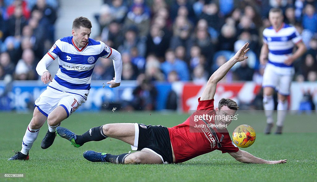 Jamie Mackie of Queens Park Rangers (L) fouls Kevin McDonald of Fulham FC (R) during the Sky Bet Championship match between Queens Park Rangers and Fulham at Loftus Road on January 21, 2017 in London, England.
