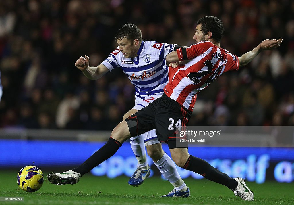 Jamie Mackie of Queens Park Rangers holds off a challenge from Carlos Cuellar during the Barclays Premier League match between Sunderland and Queens Park Rangers at the Stadium of Light on November 27, 2012, in Sunderland, England.